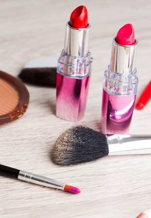 Various Cosmetics on wooden table photo