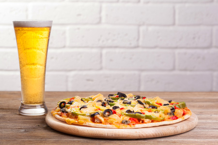 pizza on the table with a glass of beer  Stock Photo