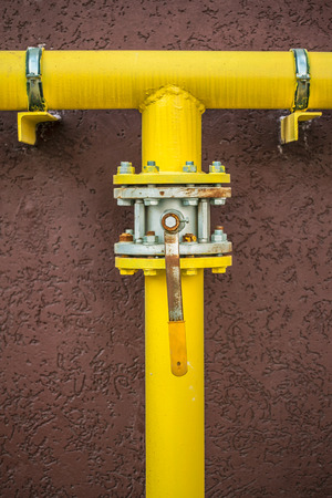 yellow gas pipe with a crane and gear  Stock Photo