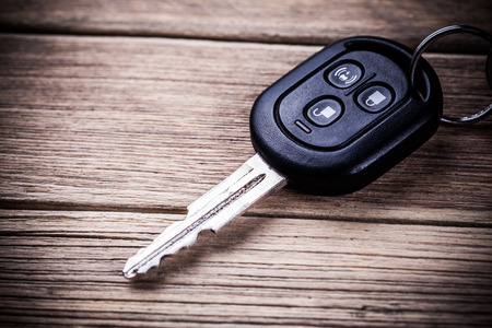 car accessory: Car key on wooden background Stock Photo