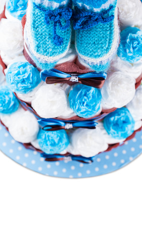 cake made from diapers on white background photo