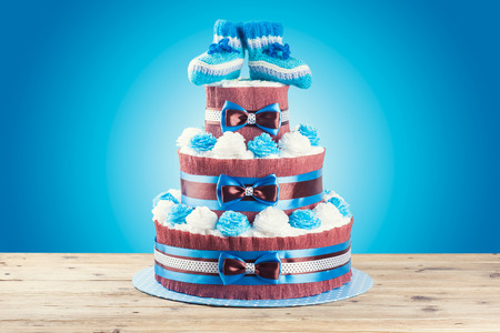 cake made from diapers standing on wooden table