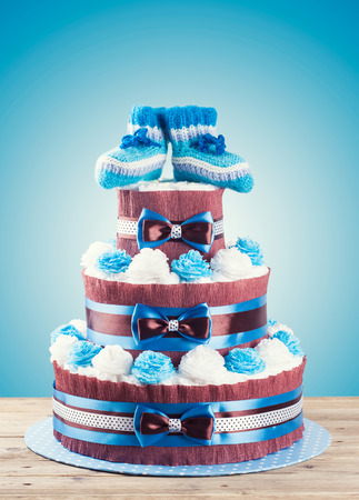 cake made from diapers standing on wooden table photo