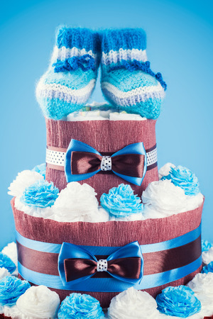 cake made from diapers on blue background photo