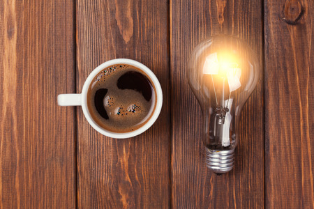 cup of fresh espresso with bulb photo