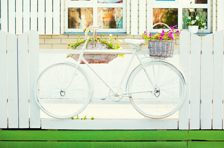 vintage bicycle on vintage wooden house photo