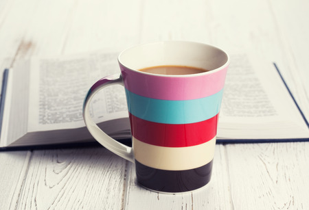 cup of coffee on wooden background photo