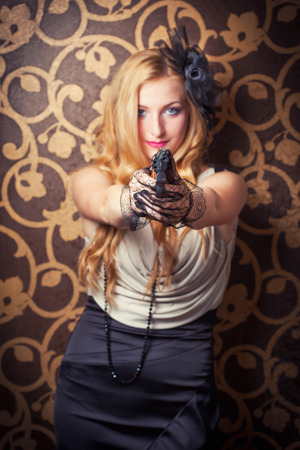 special service agent: beautiful retro woman holding a revolver Stock Photo