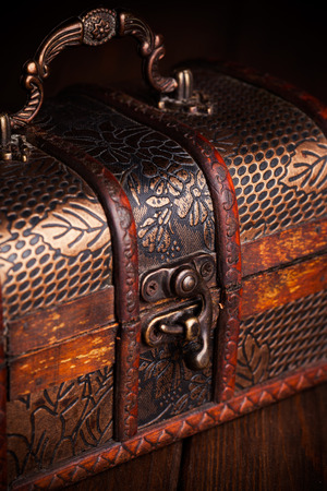 closed treasure chest standing on wooden table photo