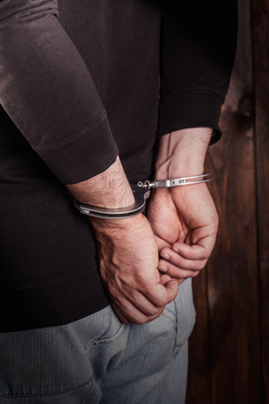 man hands in handcuffs  photo