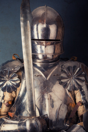 knight wearing armor and holding two-handed sword photo