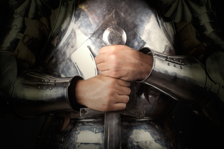 knight wearing armor and holding two-handed sword Stock Photo