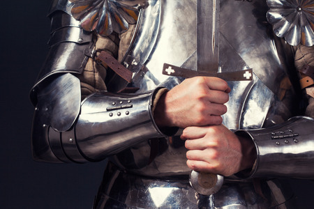 fantasy sword: knight wearing armor and holding two-handed sword Stock Photo