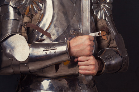 longsword: knight wearing armor and holding two-handed sword Stock Photo