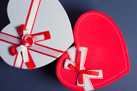 goodie: red and white heart gift boxes on red background