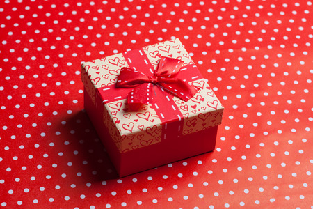 goodie: gift box on red background