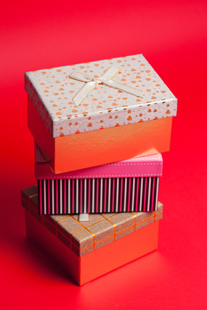 gift boxes on red background photo