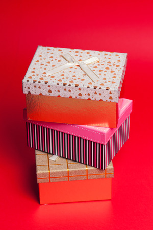 goodie: gift boxes on red background Stock Photo