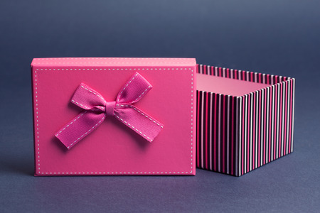 goodie: gift box on gray background Stock Photo