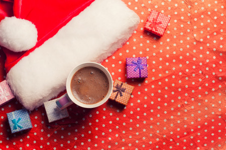 contiguous: Christmas santa hat with a cup of coffee