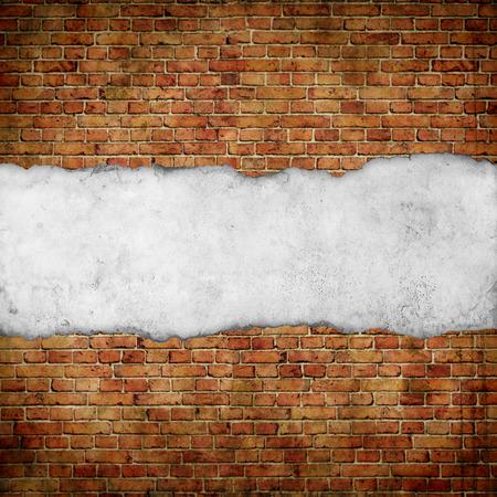 vintage paper on old red brick wall Foto de archivo
