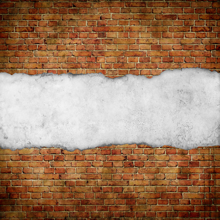 vintage paper on old red brick wall Stockfoto