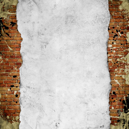 vintage paper on old red brick wall Stock Photo