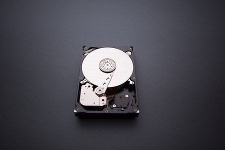 hdd: Hard disk drive HDD on gray background Stock Photo