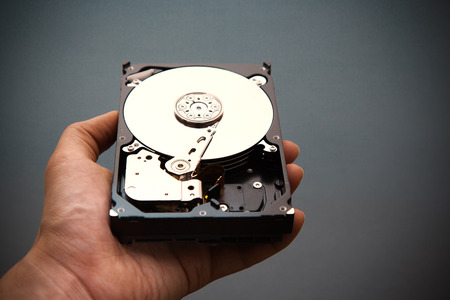 hdd: Hard disk drive HDD in hand