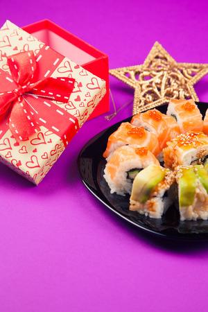 Maki sushi on purple background Stock Photo
