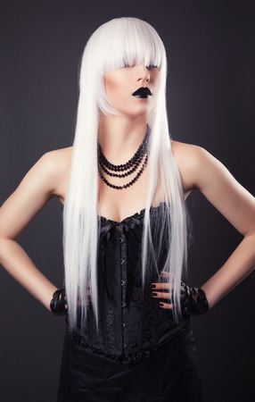 beautiful blonde woman with black make-up and accessories photo