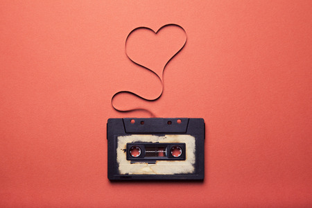 audio cassette with magnetic tape in shape of heart 스톡 콘텐츠