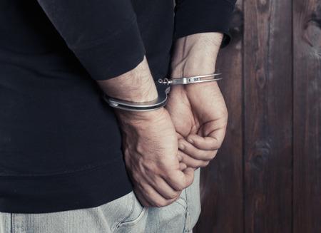 handcuffs: man hands in handcuffs