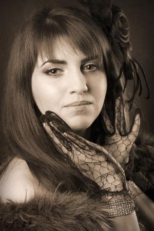 black boa: portrait of beautiful young retro woman Stock Photo