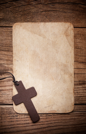 holy cross: wooden cross on paper background