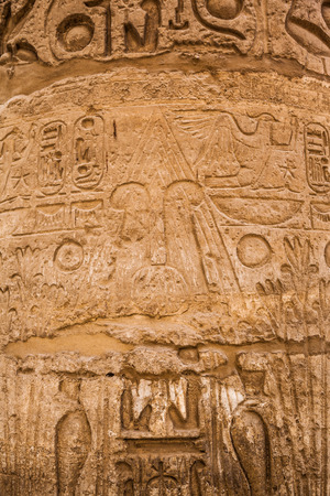 old egypt hieroglyphs carved on the stone photo