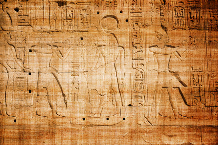 papyrus: old egypt hieroglyphs carved on the stone with papyrus scratches Stock Photo