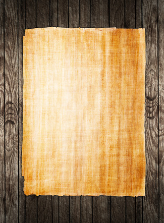 papyrus: old papyrus paper on wooden background Stock Photo