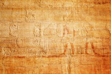 old egypt hieroglyphs on papyrus background