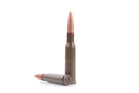 m16 ammo: Two rifle bullets over white background