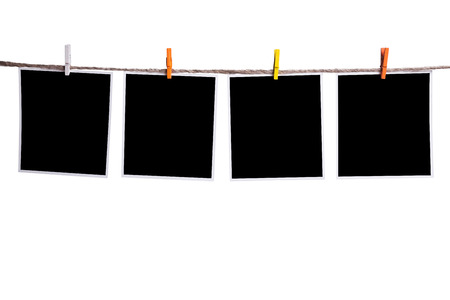 Blank instant photo hanging on the clothesline photo