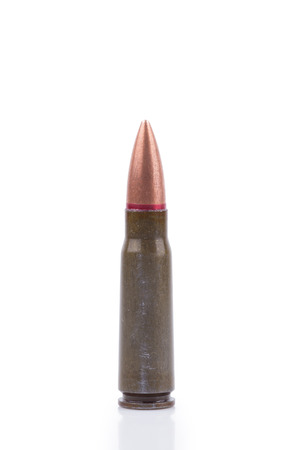 m16 ammo: Single rifle bullet over white