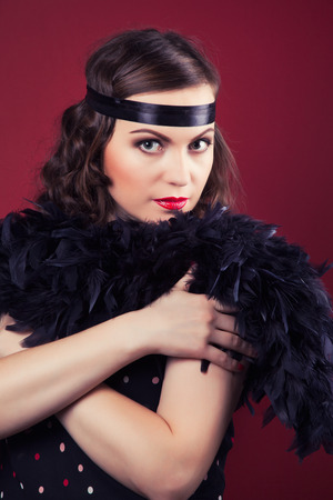 silent film: beautiful retro woman posing against wine red background
