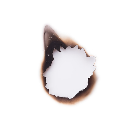 burned: Burned hole on a white background