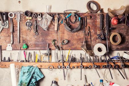Old vinrtage tools on the wall Archivio Fotografico