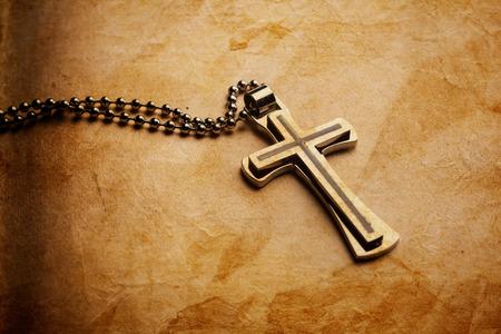 Closeup of silver Christian cross on bible