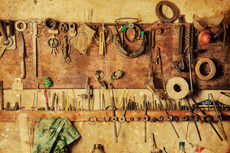 workroom: Old vinrtage tools on the wall Stock Photo
