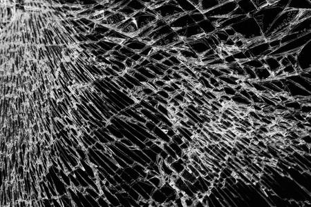 Broken glass on black background, concept of violence Archivio Fotografico