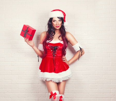 fresh girl: beautiful sexy girl wearing santa claus clothes with christmas gift