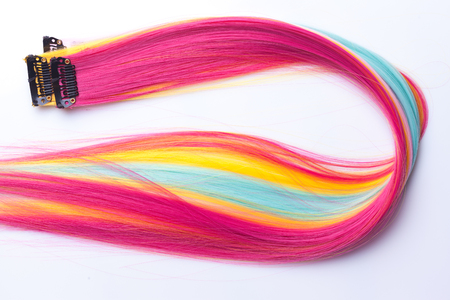 peruke: Color clip in hair extension, closeup on white